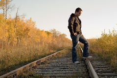 Melancholy. A man outside standing on some tracks, in a melancholy mood Stock Images