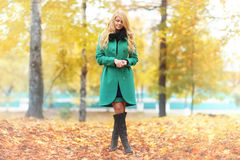 Melancholy blond woman in autumn forest Royalty Free Stock Image