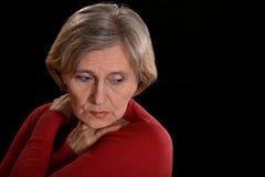 Melancholy elderly woman Stock Photo