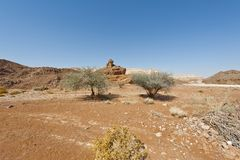 Melancholy and emptiness of the desert in Israel. Melancholy and emptiness of the rocky hills of the Negev Desert in Israel. Breathtaking landscape and nature of stock photos