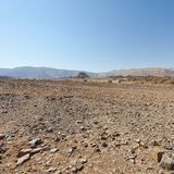 Melancholy and emptiness of the desert in Israel. Melancholy and emptiness of the rocky hills of the Negev Desert in Israel. Breathtaking landscape and nature royalty free stock photography