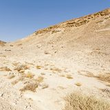 Melancholy and emptiness of the desert in Israel. Melancholy and emptiness of the rocky hills of the Negev Desert in Israel. Breathtaking landscape and nature of royalty free stock photo