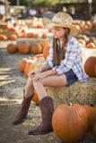 Melancholy Girl Portrait at the Pumpkin Patch Royalty Free Stock Photo