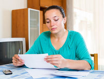 Melancholy girl working with documents Royalty Free Stock Photography