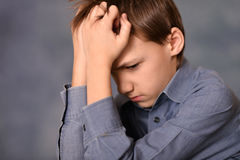 Melancholy little boy Stock Photo