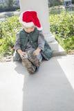 Melancholy Mixed Race Boy Wearing Christmas Santa Hat Stock Images