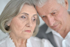 Melancholy Senior couple Stock Image