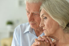 Melancholy Senior couple Stock Images