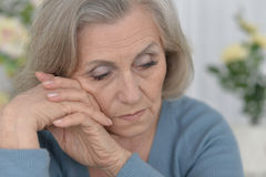 Melancholy Senior woman. Portrait of a melancholy senior woman close up Stock Photography
