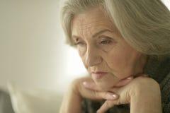 Melancholy Senior woman Stock Photo