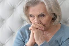 Melancholy Senior woman Stock Image