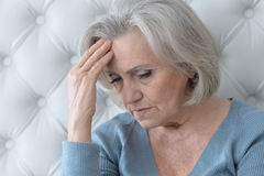 Melancholy Senior woman. Portrait of a melancholy senior woman close up Royalty Free Stock Image