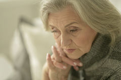 Melancholy Senior woman Stock Image