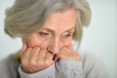 Melancholy Senior woman. Portrait of a melancholy senior woman close up Royalty Free Stock Images