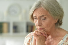 Melancholy Senior woman. Portrait of a melancholy senior woman close up Stock Photo
