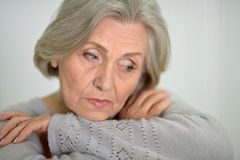 Melancholy Senior woman. Portrait of a melancholy senior woman close up Stock Image