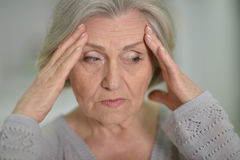 Melancholy Senior woman. Portrait of a melancholy senior woman close up Royalty Free Stock Photography
