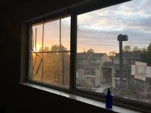 Melancholy sunset hitting window pane. Beautiful melancholy light from a sunset hitting a broken window at home royalty free stock image
