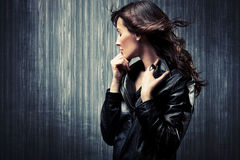 Melancholy woman. Melancholy adult woman in black leather  jacket profile portrait Stock Images