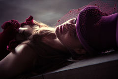 Melancholy woman. Young elegant woman wearing mesh hat outdoor shot Stock Images