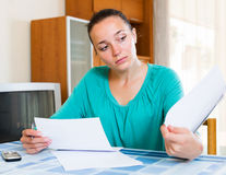 Melancholy woman working with documents Stock Photography