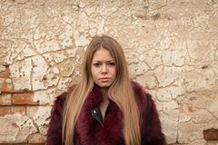 Melancholy young girl with red fur coat Royalty Free Stock Photo
