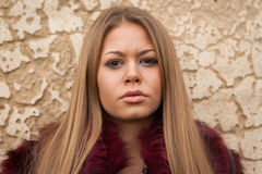 Melancholy young girl with red fur coat Royalty Free Stock Photos