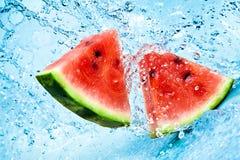 Melancia e água Imagem de Stock Royalty Free