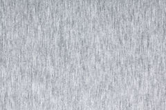 Melange jersey knit fabric pattern. Real heather grey knitted fabric made of synthetic fibres textured background Royalty Free Stock Images