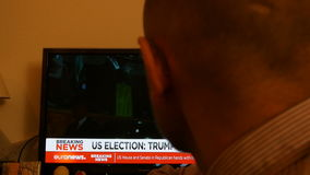 Melania Trump -President Breaking news. PARIS, FRANCE - NOV 9, 2016: Man watching TV breaking news Melania Trump after US President Elections as Donald Trump is stock video footage