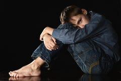 Melankolisk ung pojke Fotografering för Bildbyråer
