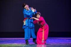 Melankoliskt sära - den nationella folkdansen arkivfoto