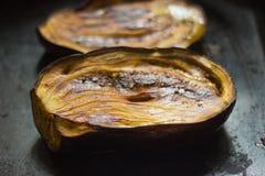 Melanzana al forno nel forno Fotografie Stock