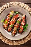 Melanzane al forno con i pomodori, la cipolla e l'aglio Alimento vegetariano sano Fotografie Stock
