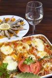 Melanzane alla Parmigiana och Marinated sardiner Arkivbilder