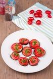 Melanzane arrostite con i pomodori Immagini Stock