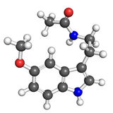 Melatonin molecule. Ball and stick model of melatonin, hormone that regulates daily cycle. Atoms are coloured according to convention (nitrogen-blue; carbon-gray Royalty Free Stock Photos