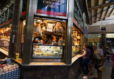MELBOURNE, AUS - APR 12 2014: Shoppers at Queen Victoria Market. Royalty Free Stock Images