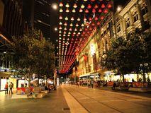 The color of Bourke Street Mall, Melbourne at night time. MELBOURNE, AUSTRALIA. – On December 26, 2013 – The color of Bourke Street Mall, Melbourne at night Royalty Free Stock Photography