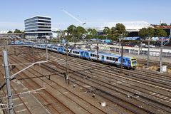 Metro Train arriving into Flinders Street Station stock photos