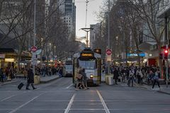 MELBOURNE, AUSTRALIA, AUGUST 16 2017 - City traffic in center bourke and flinder street royalty free stock images