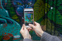 Melbourne, Australia - August 22, 2015: taking a photo of street art in Melbourne, Australia. Melbourne, Australia - August 22, 2015: Male hands holding a mobile royalty free stock images