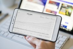 Analyzing the chart of Dow Jones Industrial Average on a smartphone. Melbourne, Australia - Feb 2, 2018: Analyzing the chart of Dow Jones Industrial Average royalty free stock image