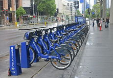 MELBOURNE, AUSTRALIA - JANUARY 15, 2015: City bikes for rent on Royalty Free Stock Image