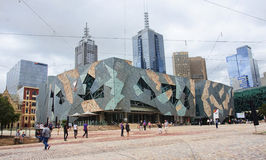 MELBOURNE, AUSTRALIA - JANUARY 14, 2015: Federation Square on 14. January 2015 in Melbourne, Australia. Federation Square is a meeting place in the city center royalty free stock image