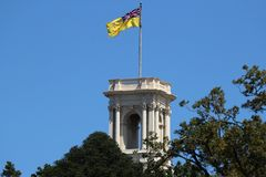 The flag of the Governor of Victoria raised over the belvedere tower of Government House, Melbourne. MELBOURNE, AUSTRALIA - JANUARY 28, 2019: The flag of the stock photography