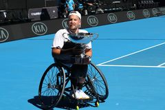 Grand Slam champion Dylan Alcott of Australia during trophy presentation after 2019 Australian Open quad wheelchair singles final. MELBOURNE, AUSTRALIA - JANUARY royalty free stock photo