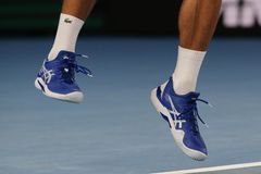 Grand Slam champion Novak Djokovic of Serbia wears custom Asis tennis shoes during his final match at 2019 Australian Open. MELBOURNE, AUSTRALIA - JANUARY 27 stock images