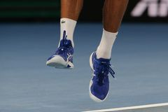 Grand Slam champion Novak Djokovic of Serbia wears custom Asis tennis shoes during his final match at 2019 Australian Open. MELBOURNE, AUSTRALIA - JANUARY 27 stock image