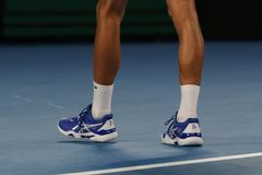 Grand Slam champion Novak Djokovic of Serbia wears custom Asis tennis shoes during his final match at 2019 Australian Open. MELBOURNE, AUSTRALIA - JANUARY 27 royalty free stock photos